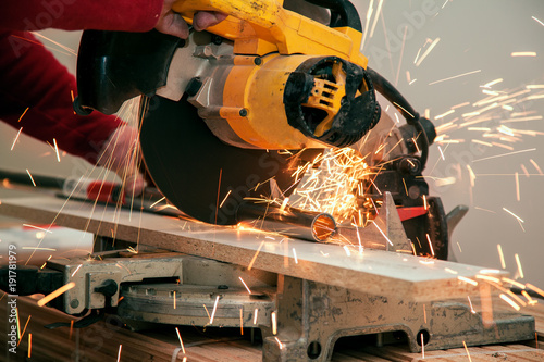 Fotografie, Obraz  Cutting of a metal pipe with splashes of sparks