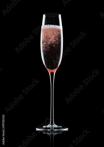 Rose pink champagne glass with bubbles on black