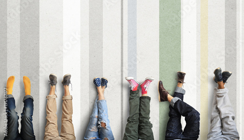 Fotografie, Obraz  People's legs at the wall during a break in work