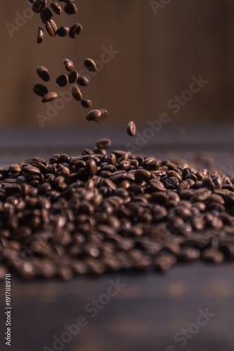 Fototapety, obrazy: roasted coffee beans fall on dark wooden table