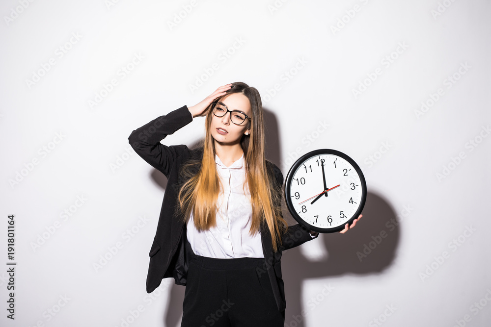 Fototapety, obrazy: Young businesswoman holding clock with start of office work hours isolated on white background