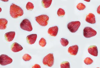 Texture of strawberry in milk. Strawberry islands in the milk ocean.