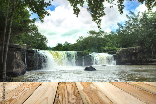 Poster Kaki Tat-Tone Waterfall in Thailand with wooden space.