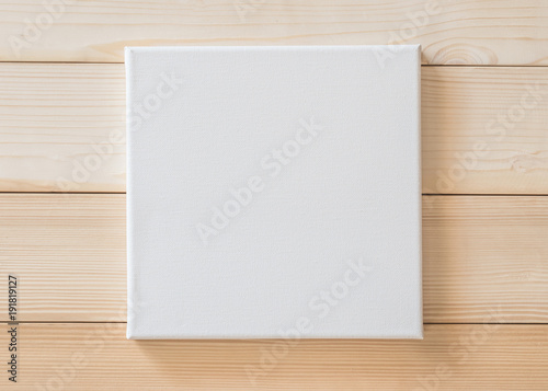 White blank canvas mockup square size on wood wall for arts painting and photo hanging interior decoration