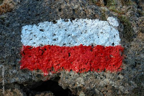 Fényképezés  Trail Mark On Volcanic Rock In Etna Park, Sicily