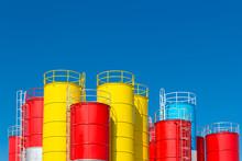 Many Color Steel Storage Tanks Against Blue Sky, Metal Silos For Concrete Mix Process Plant