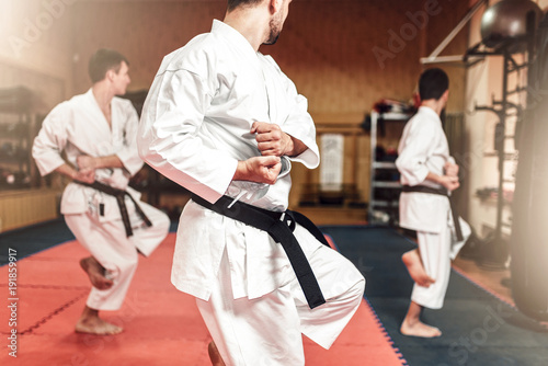 Staande foto Vechtsport Martial arts fighters on workout in gym