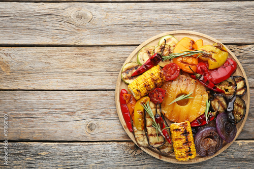 Grilled vegetable on brown cutting board Canvas Print