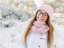 Adorable Happy Young Blonde Woman In Pink Knitted Hat Scarf Mittens Having Fun Snowy Winter Park Forest Sunny Day In Nature