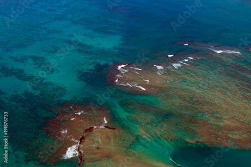 Aerial view of Pacific Ocean shoals and surf off the Hawaiian Island of Oahu, ne Poster