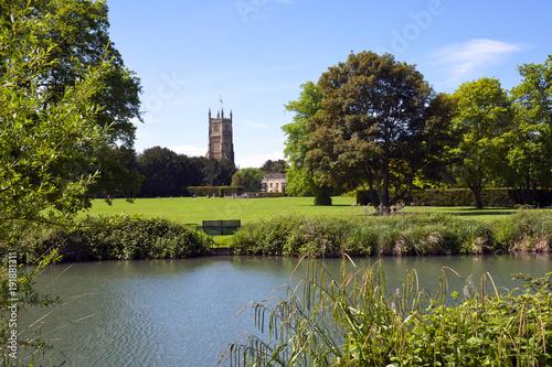 Tower of the landmark Abbey Church seen across Abbey Grounds in spring sunshine, Wallpaper Mural