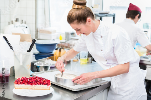 Fotografiet Women in pastry shop bakery making pies and cakes ready