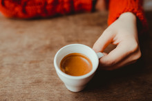 Woman Is Holding In Hand Hot Coffee Espresso In White Small Glass Cup
