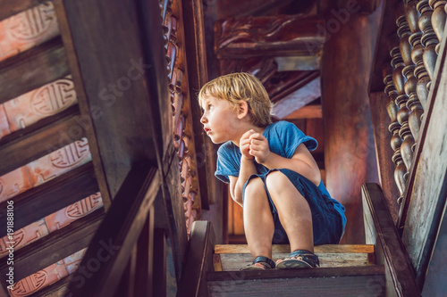 Poster de jardin Havana Boy tourist in Pagoda. Travel to Asia concept. Traveling with a baby concept
