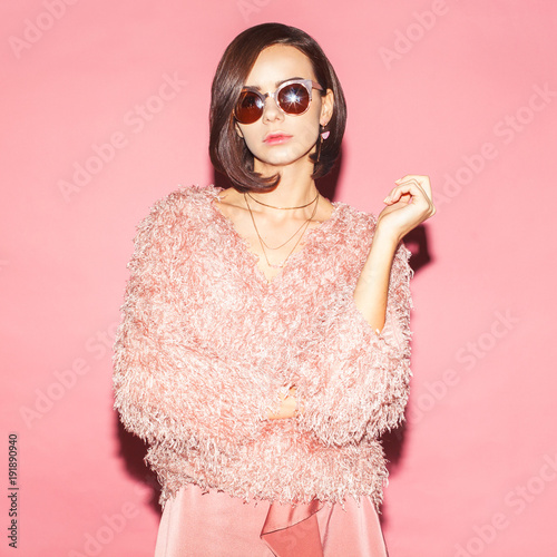 young female fashion model in pink total look on pink background Wall mural