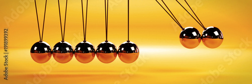 Fototapeta cause and effect concept, metal Newton's cradle with two balls in motion on a wh