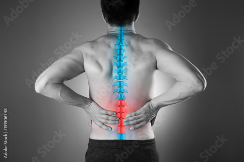Fotomural  Pain in the spine, a man with backache, injury in the lower back