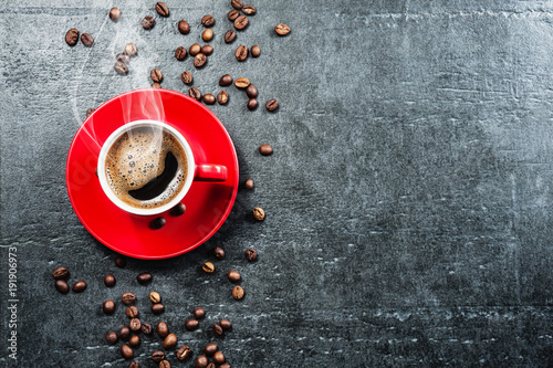 Spoed Foto op Canvas Cafe Coffee cup background with coffee beans top view.