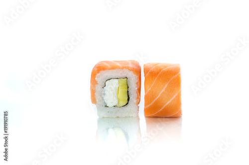 Fototapeta Uramaki maki sushi, two rolls isolated on white. Salmon with philadelphia, avocado and cucumber obraz