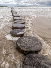 Old And Weathered Wooden Wave Breakers