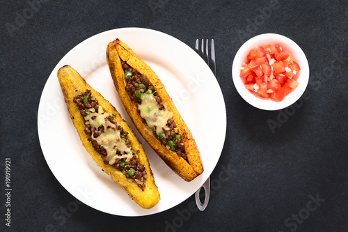Baked ripe plantain stuffed with mincemeat, olive, green bell pepper, onion, cheese, traditional dish in Central America called Canoa de Platano (Plantain Canoe)