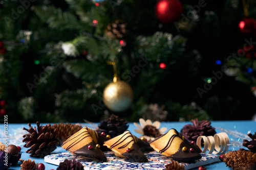 traditional chinese fortune cookies delicious chocolate fortune cookies on a blue background with christmas decorations