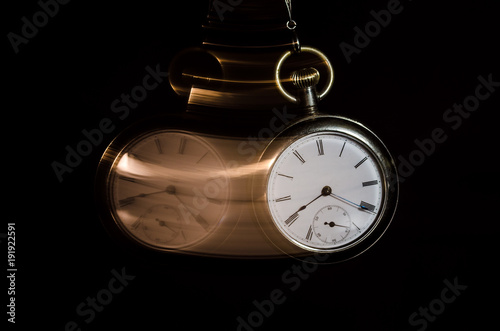 Fotografie, Obraz  Swinging Pocket Watch Beckoning You to Look More Closely