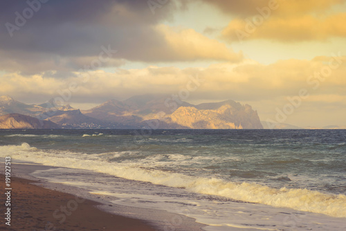 Foto op Aluminium Grijs Seascape on a stormy sea on a mountain coast on a sunny day