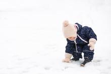 Toddler Girl Playing In The Sn...