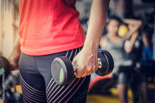 Foto op Plexiglas Fitness Close up Fitness girl lifting dumbbell in the morning.