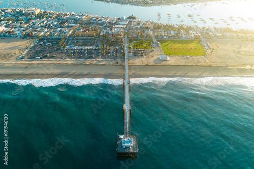 Cuadros en Lienzo Aerial view of Balboa Pier in Newport Beach Beach, California at sunrise
