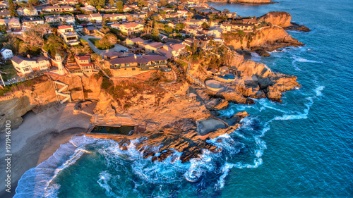 Aerial view of Three Arch Bay in Laguna Beach, Orange County, California during twilight