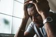 Leinwanddruck Bild - Black guy stressting and headache