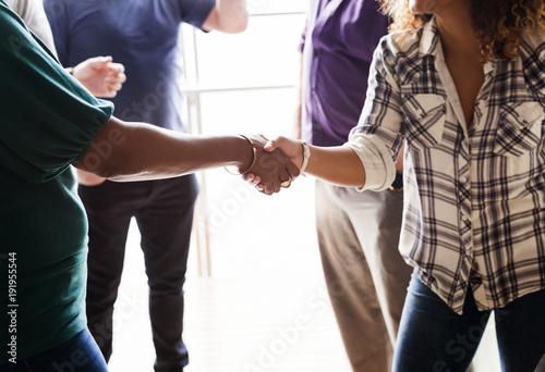 Obraz Diverse woman shaking hands - fototapety do salonu