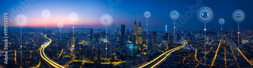 Obraz Panorama aerial view in the  cityscape skyline  with smart services and icons, internet of things, networks and augmented reality concept , early morning sunrise scene . - fototapety do salonu