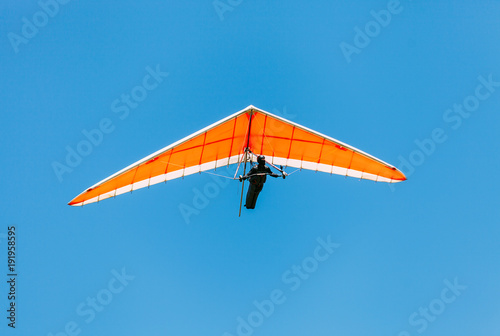 Soaring hang gliding in the sky