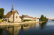The Catholic church of Saint-Maurice in Sens, Burgundy, France, reflected in the river Yonne
