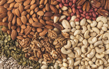 A Variety Of Nuts And Seeds Ba...
