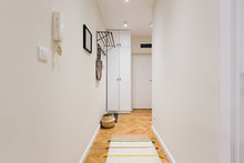 Entrance Corridor With White C...