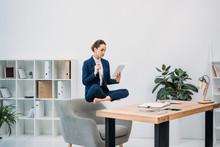Businesswoman Using Digital Ta...