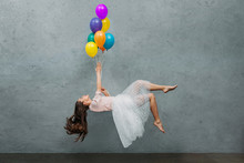Young Woman Levitating With Co...