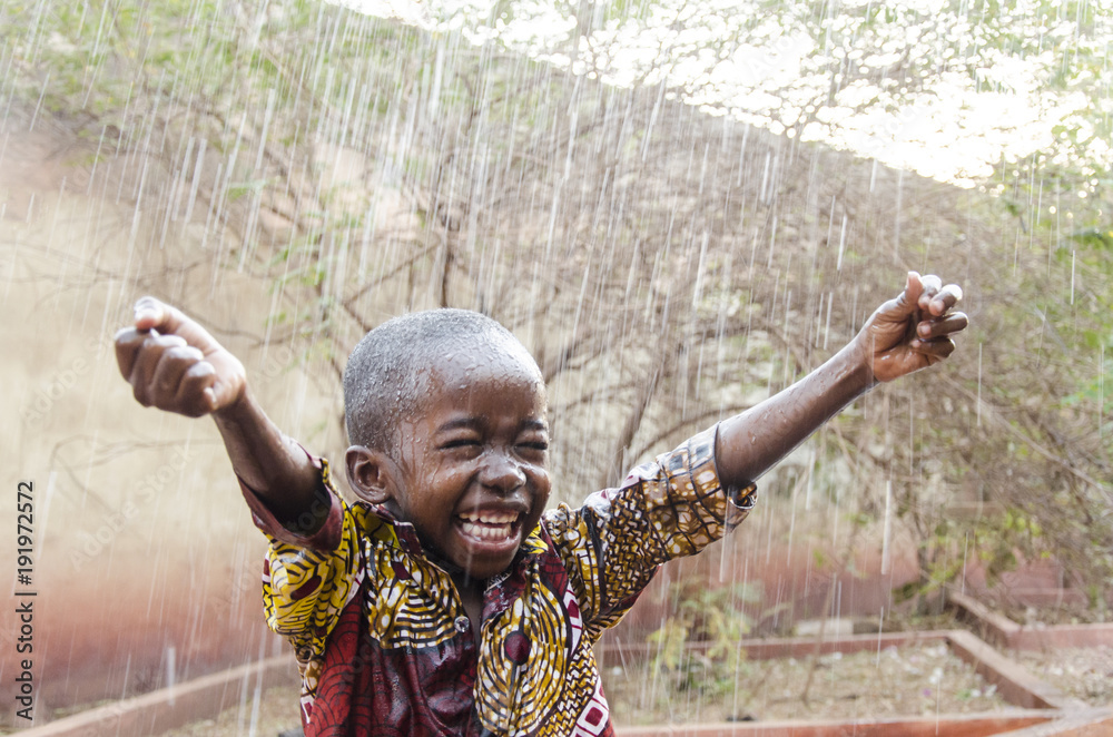 Fototapety, obrazy: Water is coming! African ethnicity little boy happy to finally get some rain