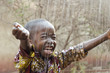 canvas print picture - Little Native African Boy Standing Outdoors Under the Rain (Water for Africa Symbol)