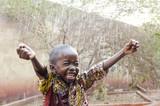 Fototapeta Łazienka - Water is coming! African ethnicity little boy happy to finally get some rain