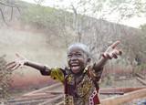 Fototapeta Łazienka - Sweet little African boy under the rain in Mali (Africa)