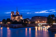 Notre-Dame Cathedral with light & Seine River at night