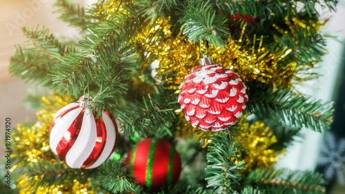 Garden Poster Roe Red ball hanging on a Christmas tree.
