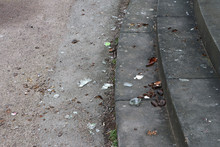 Stairs And Ground Full With Broken Glass And Bottles