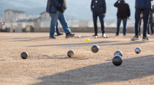 Petanque French Traditional Game / People Playing Petanque Under The Sun Of Marseille