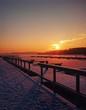 Winter sunrise on the lake of Poland